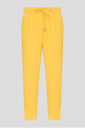 Женские желтые брюки