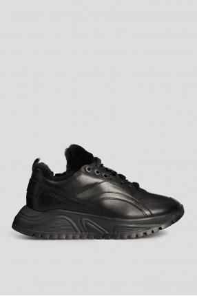 Жіночі чорні шкіряні кросівки з хутром
