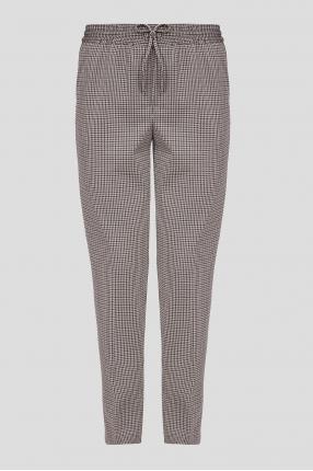 Жіночі бежеві брюки з візерунком
