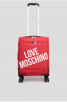 Женский красный чемодан