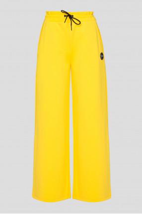 Женские желтые спортивные брюки