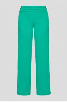 Женские зеленые спортивные брюки