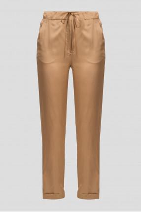 Женские золотистые брюки